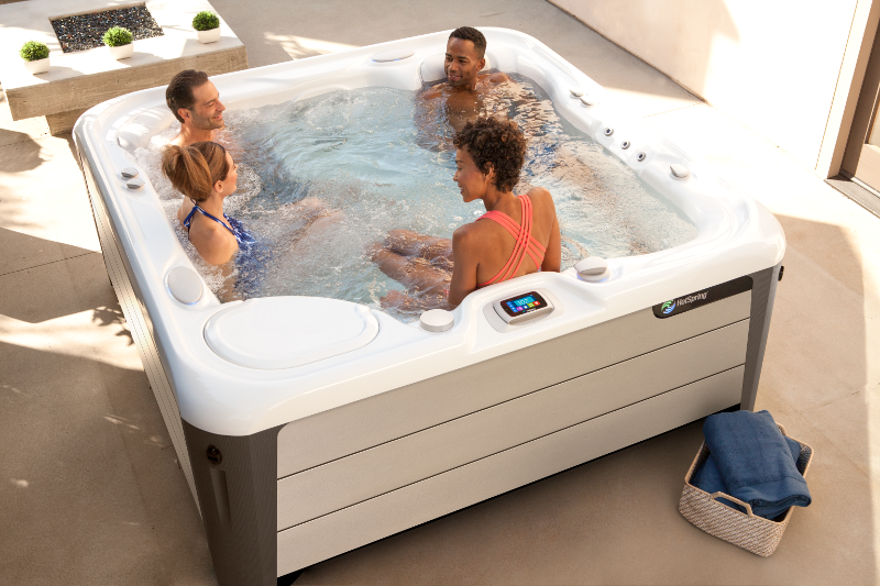 The spacious 5-seater Highlife® Aria™ (seen here in Alpine White shell and Sand Stone cabinet) | HotSpring Spas
