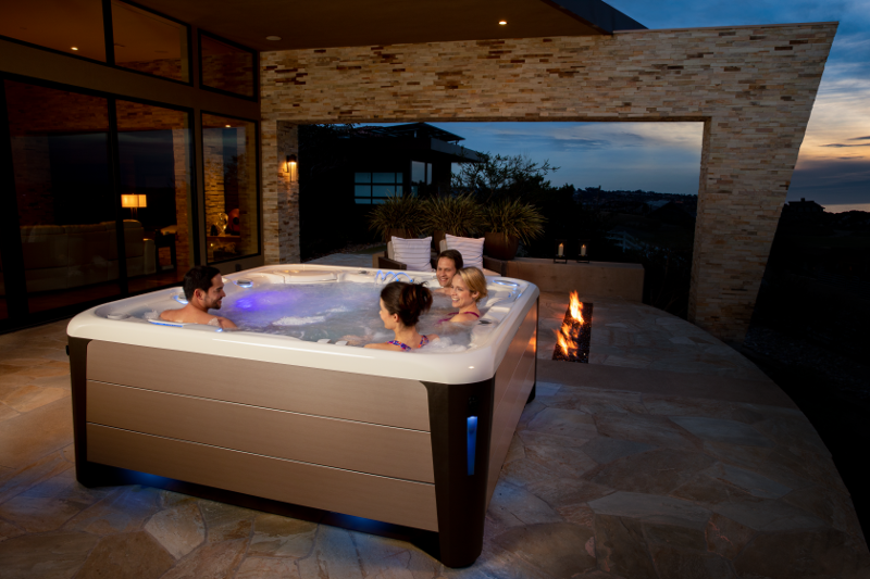 The Highlife® Envoy™ - luxurious relaxation for all (seen in Alpine White shell and Bronze cabinet) | HotSpring Spas