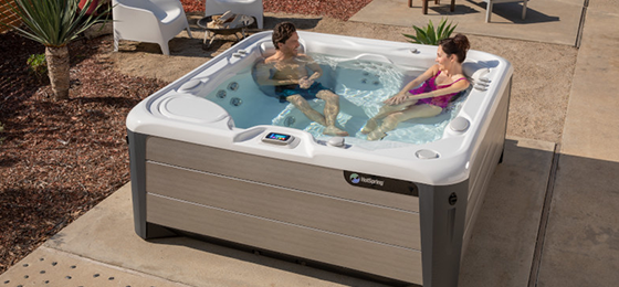 hot spring spas hot tub hot spa grass 560x260 v2